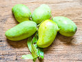 Fresh green mango rhino mango on wood background Royalty Free Stock Photo