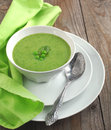 Fresh green pea soup selective focus focus on the pea in the middle of the soup Stock Photos