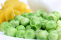 Fresh green peas with other snacks close up image of Stock Photos