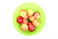 Fresh green, red apples in basket isolated Royalty Free Stock Photo