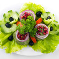 Fresh green salad with baby spinach spinachon white surface Stock Image