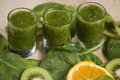 Fresh green smoothie with spinach and kiwi healthy on wooden table Stock Photography
