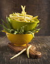 Fresh green and yellow beans on wooden table Stock Images