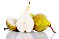 Fresh greeny pears divided into two over white green background Stock Photo