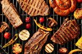 Fresh grilled meat steaks and vegetables on barbecue grate Royalty Free Stock Photo