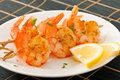 Fresh grilled shrimps with lemon on white plate Stock Photography