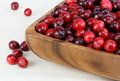 Fresh, healthy cranberries in a wooden bowl. Royalty Free Stock Image
