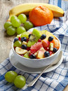 Fresh healthy fruit salad bowl of on checkered tablecloth Stock Photography
