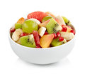 Fresh healthy fruit salad bowl of on white background Royalty Free Stock Images