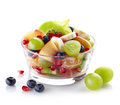 Fresh healthy fruit salad bowl of on white background Stock Image