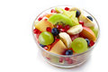 Fresh healthy fruit salad bowl of on white background Stock Photo