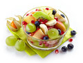 Fresh healthy fruit salad bowl of on white background Stock Photos