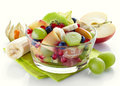 Fresh healthy fruit salad bowl of on white background Stock Photography
