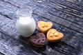 Fresh healthy milk and muffins delicious on a wooden background Stock Photo