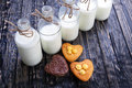Fresh healthy milk and muffins delicious on a wooden background Stock Photos