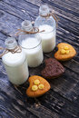 Fresh healthy milk and muffins delicious on a wooden background Stock Images