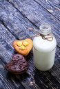 Fresh healthy milk and muffins delicious on a wooden background Royalty Free Stock Image
