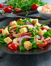 Fresh Healthy Prawns salad with tomatoes, red onion on black plate. concept healthy food Royalty Free Stock Photo