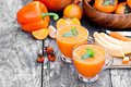 Fresh healthy pulpy cocktail with orange fruits and berries and vegetables Stock Photos