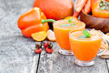 Fresh healthy pulpy cocktail with orange fruits and berries and vegetables Stock Image