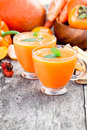 Fresh healthy pulpy cocktail with orange fruits and berries and vegetables Royalty Free Stock Photos