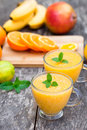 Fresh healthy pulpy juice with orange fruits and vegetables Royalty Free Stock Photo