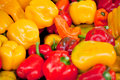 Fresh healthy red yellow geen paprika pepper macro closeup market outdoor Stock Photo