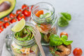Fresh healthy salad in glass jar and ingredients Royalty Free Stock Photo