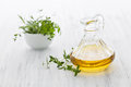 Fresh herb oil in a bottle Stock Photo