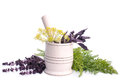 Fresh herbs mortar and pestle to grind the leaves green seasoning Stock Photography