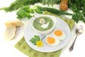 Fresh herbs soup with a dollop of cream eggs and daisy Royalty Free Stock Photos