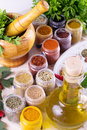 Fresh herbs spices and oil with mortar mix of on the table Royalty Free Stock Image