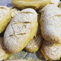 Fresh home-made bread, small wheat rolls, flour products, bread Royalty Free Stock Photo
