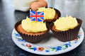 Fresh home made cupcakes lemon drizzle with the union jack flag denoting typical british fayre Stock Images