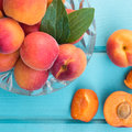 Fresh homegrown apricots on pastel blue wooden table Royalty Free Stock Photography
