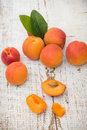 Fresh homegrown apricots on vintage white wooden tabl table Royalty Free Stock Photography