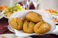 Fresh homemade bread rolls with sesam seeds on holiday table Royalty Free Stock Photo