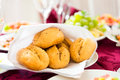 Fresh homemade bread rolls with sesam seeds on holiday table Stock Images