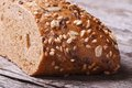Fresh homemade bread with seeds and nuts closeup on a wooden table macro Royalty Free Stock Photos