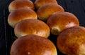 Fresh homemade burger buns on black background Stock Photos