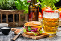 Fresh homemade burger cold beer old wooden table Stock Photos