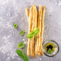 Fresh homemade crispy bread sticks with thyme and sea salt on a gray concrete background   herbs Royalty Free Stock Photo