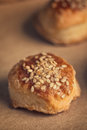 Fresh homemade salty scones with cheese and sesame tasty baking food product on kraft paper macro close up selective focus Stock Images