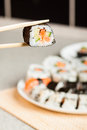 Fresh homemade sushi roll against background Royalty Free Stock Photos