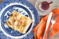 Fresh homemade turkish borek served with tea view from above of a portion of flaky phyllo pastry glass cup of and an Stock Images