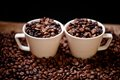 Fresh hot columbian coffee in two cups around coffee beans and cloth Stock Images