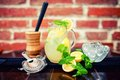 Fresh, iced mint lemonade in a jug with sliced lem
