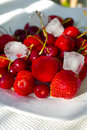 Fresh Icy berries on the plate Royalty Free Stock Photography