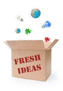 Fresh ideas various symbols of creativity and problem solving emerging from a box filled with Stock Photos