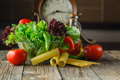 Fresh ingredients for cooking: pasta, tomato and spices Royalty Free Stock Photo